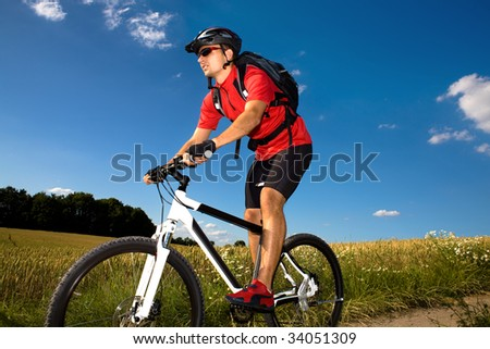 a biking man in front of nature scenes