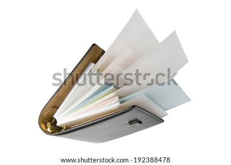 A binder full of paper with some papers sticking out. - stock photo