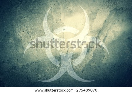 A biohazard symbol on a grunge background. - stock photo