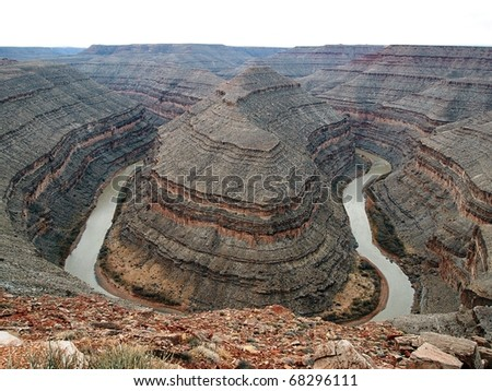 A bird's eye view of a river canyon with a 180 degree turn. - stock photo