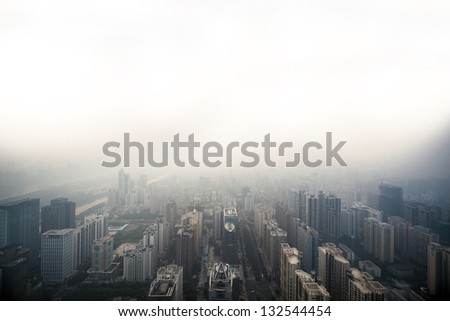 a bird's eye view of city at dusk - stock photo
