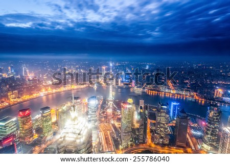 a bird's eye view of magic city of shanghai at night - stock photo