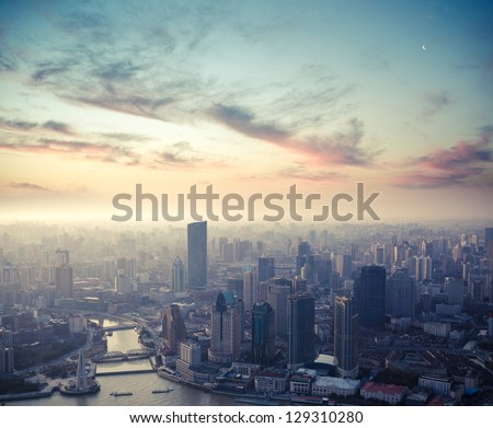 a bird's eye view of shanghai at dusk - stock photo