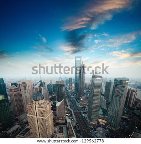 a bird's eye view of shanghai financial center at dusk - stock photo