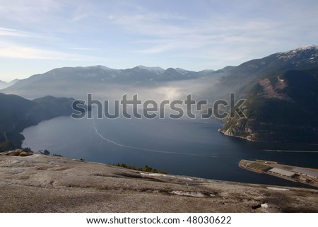 A bird view from the peak of Stawamus Chief in BC, Canada. - stock photo