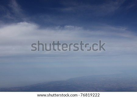 A birds eye view of Earth's atmosphere, that thin layer of important gasses, such as Oxygen and Nitrogen, responsible for most life on this planet. - stock photo