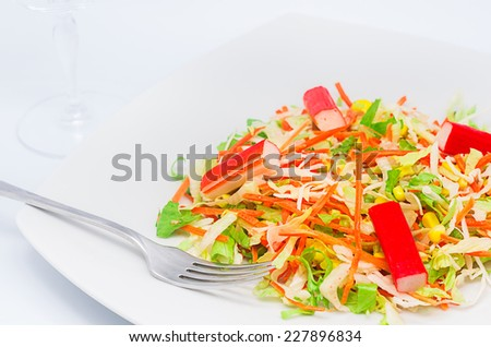 a bite of salad  isolated on a white background - stock photo