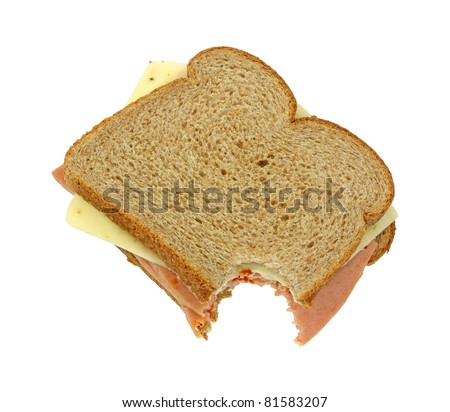 A bitten wheat bread sandwich with pickle and pimento and pepper jack cheese on a white background. - stock photo