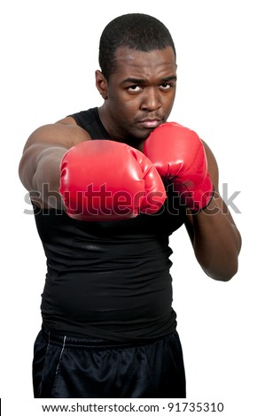A black African American man athletic boxer with boxing gloves - stock photo