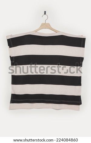 A black and pink t-shirts front side with wooden hanger isolated white background. - stock photo