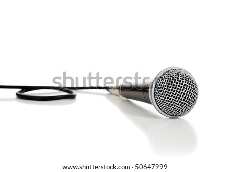 A black and silver microphone on a white background - stock photo