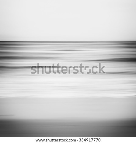 A black and white, abstract ocean seascape with blurred panning motion.  - stock photo