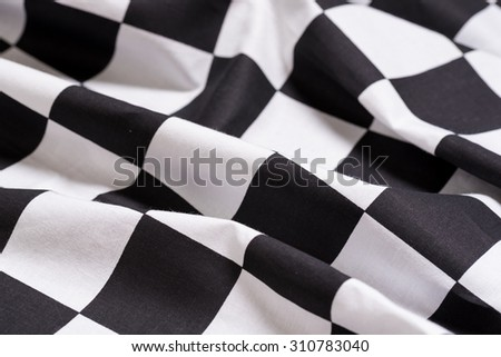 A black and white checkered flag background - motorsport racing- symbol for victory or winning - stock photo