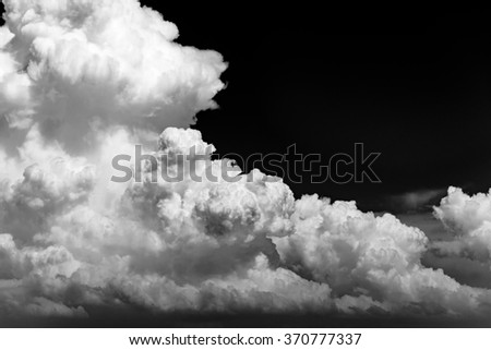A black and white cloud background.