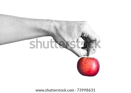 a black and white hand holding a red apple - stock photo