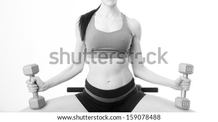 A black and white image of a beautiful female torso working out