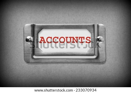 A black and white image of a metal drawer label holder with a white card and the title Accounts added in red text