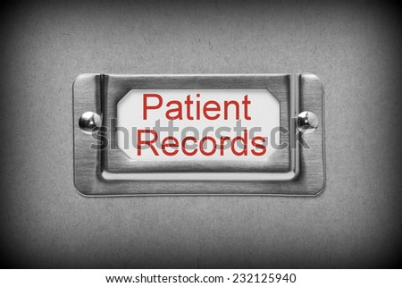 A black and white image of a metal drawer label holder with a white card and the title Patient Records added in red text - stock photo