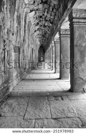 a black and white image of a reconstructed hallway which is part of ancient Khmer ruins of Cambodia
