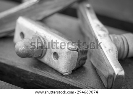 A black and white image of bicycle brake pads - stock photo
