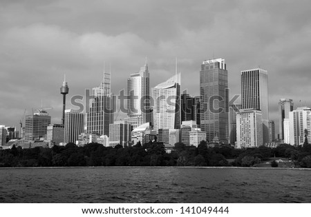 A black and white image of Sydney Skyline across farm cove on a moody day. Sydney is Australia's largest city and a popular tourist destination. - stock photo