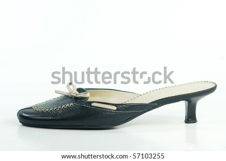 A black and white mule shoe - stock photo
