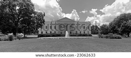 A black and white panorama of the north face of the White House in Washington, DC. - stock photo