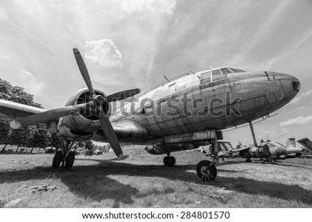 A black and white photo of an old plane - stock photo