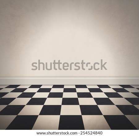 A black and white retro checkered old floor and a blank white textured wall. Add your own text message to the empty area. - stock photo