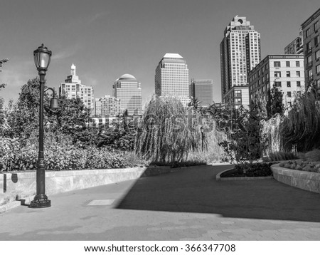 A black and white view of Battery Park in lower Manhattan. - stock photo