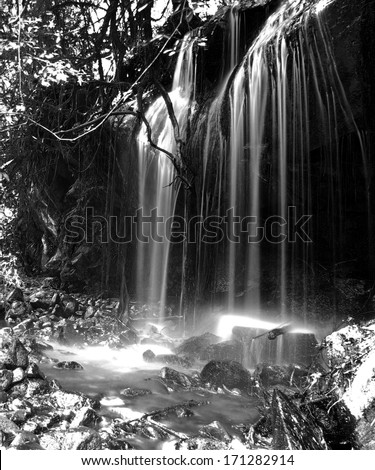 A black and white waterfall - stock photo