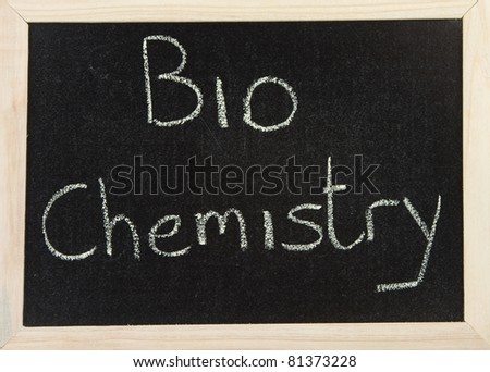 A black board with a wooden frame and the words 'BIOCHEMISTRY' written in chalk.