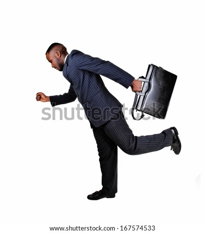 A black business man with his briefcase is running for white background in a blue suit.
