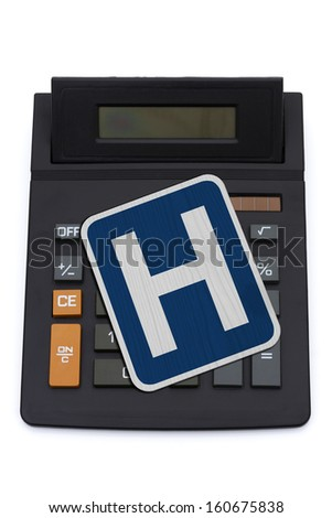 A black calculator with  isolated on a white background, Costs of ObamaCare - stock photo