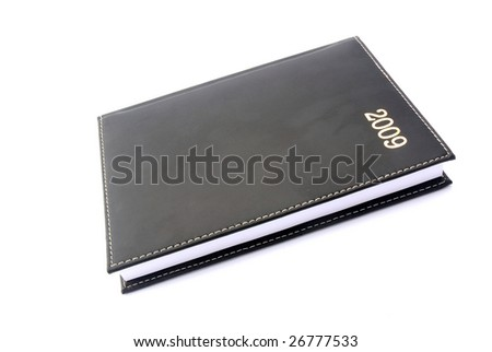 A black closed used leather diary for the year 2009 isolated on white studio background.