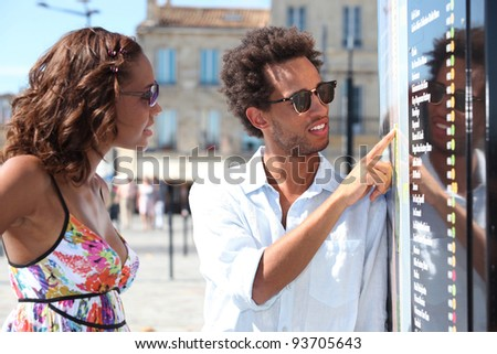 A black couple on a holiday trip. - stock photo