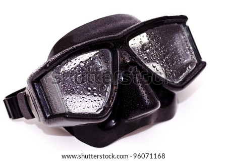 A black dive mask with water on it - stock photo