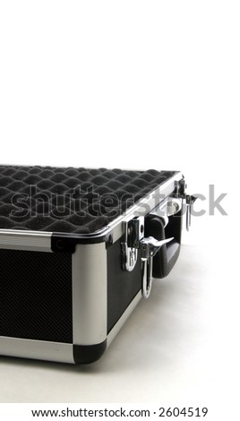 A black electronics technicians traveling toolbox provides a strong, secure container for the expensive tools of the trade, shown with protective foam padding inside.