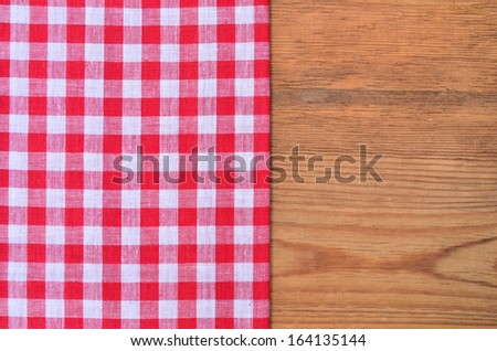 a black heart red checkered bow on wood background