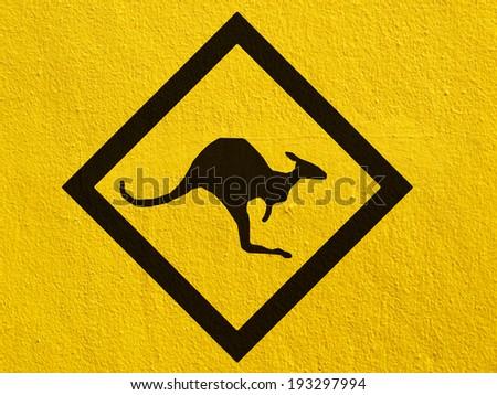 a black Kangaroo Sign painted on a stucco wall outside - stock photo
