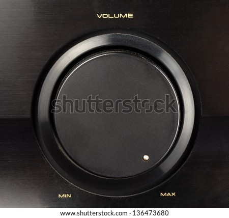 A black knob of volume turned to max - stock photo