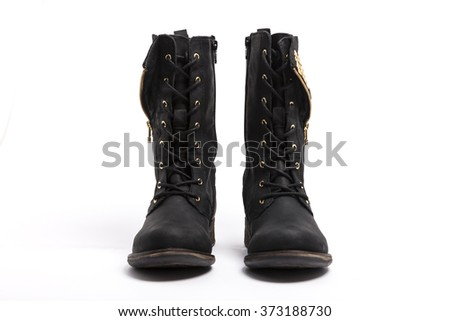 A black leather boots(shoes) for military front side view on the bottom isolated white.