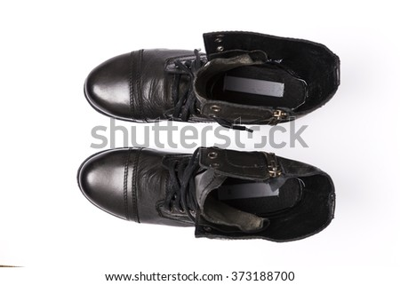A black leather boots(shoes) for military top view on the bottom isolated white.