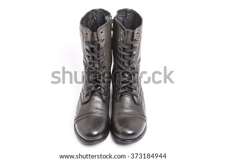 A black leather shoes for military front side on the bottom isolated white.