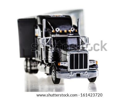 a black lorry model isolated over a white background - stock photo