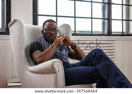 Black Male Lying On Chair Suit Stock Photo 386947909 ...