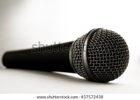 A black microphone isolated on white background - stock photo
