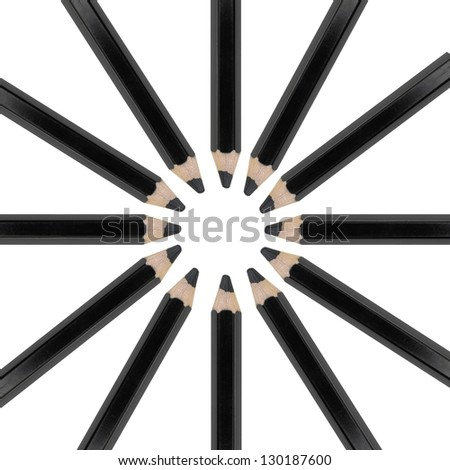 A black pencil isolated against a white background - stock photo