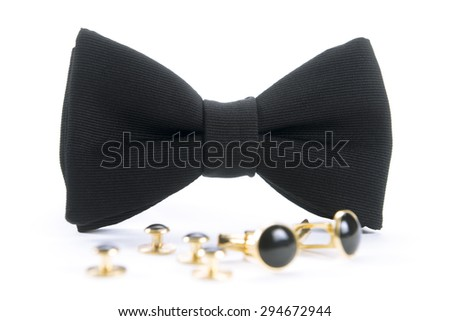 A black pre-tied bow tie with matching cuff links  - stock photo