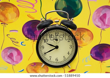 A black retro style clock on a bright balloon background, party time